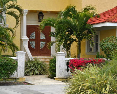 Entrance to a luxurious custom Florida home