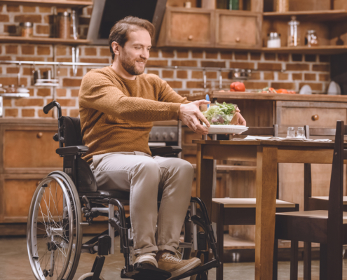 Man in Wheelchair accessible kitchen